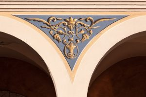 fresco on arched pillar with molding